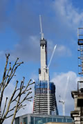Three white cranes on the Shard