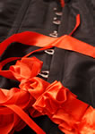 Black corset front with red ribbons