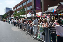 Crowds lining Ballards Lane, Finchley, London waiting for the Olympic Torch to pass through.