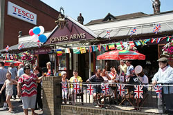 The Joiners Arms, Finchley, London with bunting and flowers.
