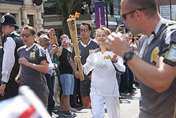 The Olympic Torch borne by Danuta Ryland passing through Finchley, London.