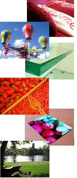 collage of photographs: burgundy towels with red and white cushions, fairground ride against blue sky, green glass shelf, tray of red sweets, photograph of white grapes and strawberries, on a table
