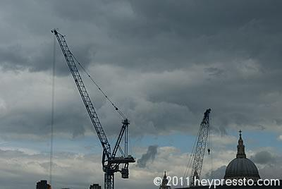 Cranes and St Paul's Cathedral, London