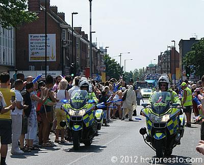 Police Bikes and Crowds on the Road for the Olympic Torch Procession