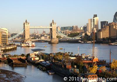 Tower Bridge and Houseboats in Winter in Early Morning